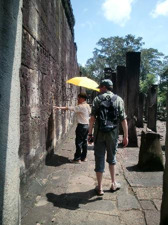 Happy Angkor Wat Tour: Full of information even in the heat of midday! (I was wilting)
