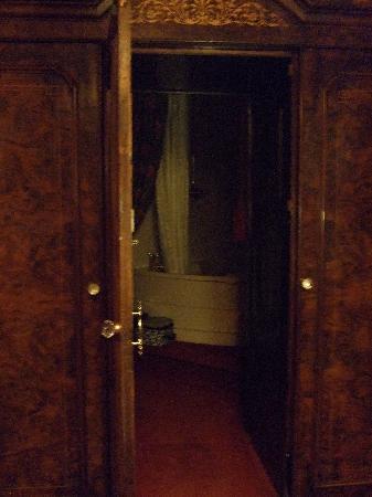 Lumley Castle Hotel: entrance to bathroom through wardrobe