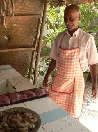 Karikkathi Beach House: Cook with shrimps