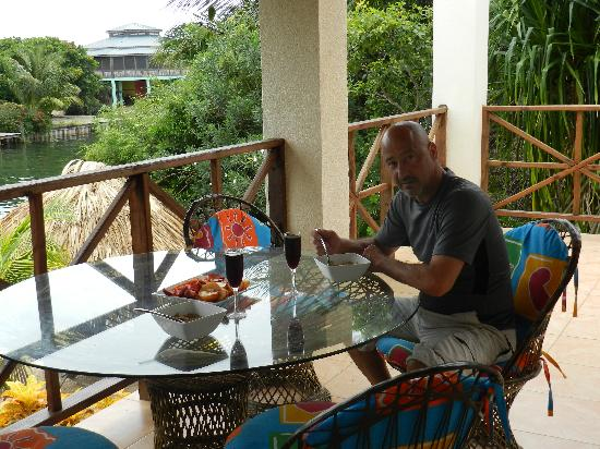 Three Iguanas Villa: Jim enjoying lunch overlooking the lagoon.