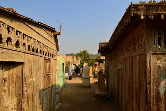 City of the Dead (Northern Cemetery): wooden houses housing a tomb