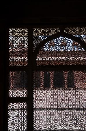 Jama Masjid: View through the carved marble window from the tomb