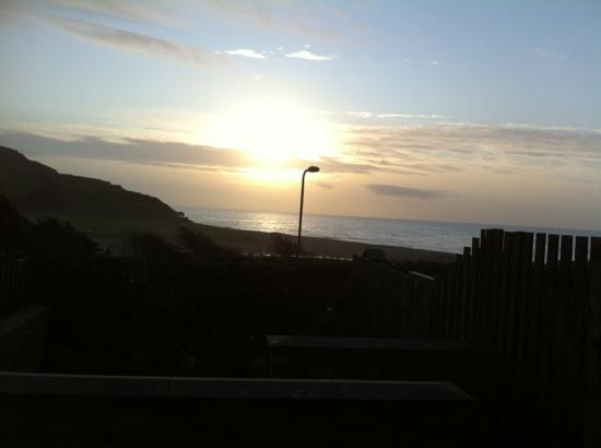 sunrise in November from the beach rooms Charmouth
