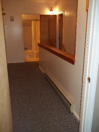 Attitash Mountain Village : unit 2A upstairs hall, looking from big bedroom doorway towards bath/stairs/queen BR