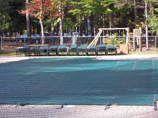 Attitash Mountain Village: AMV outdoor swimming pool w/ playset in background