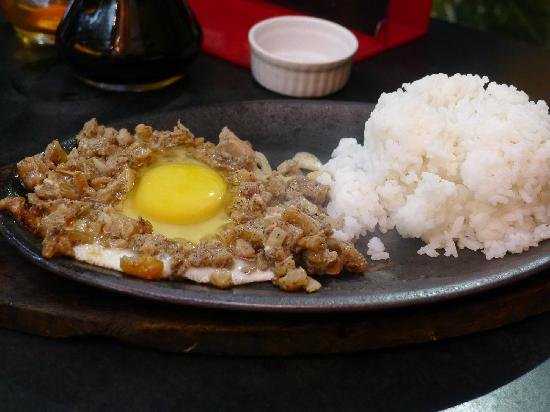 COWBOY GRILL: Sisig with egg and rice