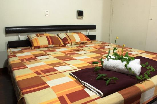 In & Basic Hostel Lounge: Our privste bed with bath