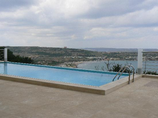 Panorama Hotel : Infinity Pool looking across Mellieha Bay