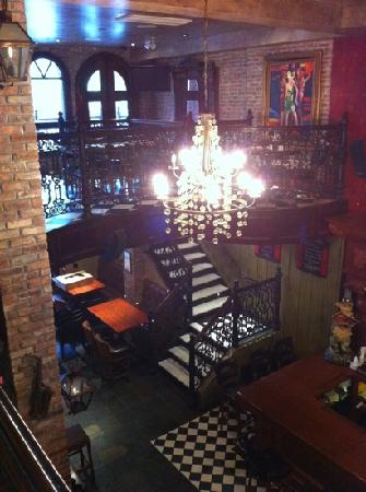 The French Quarters Guest Apartments: bar view from the mezzanine
