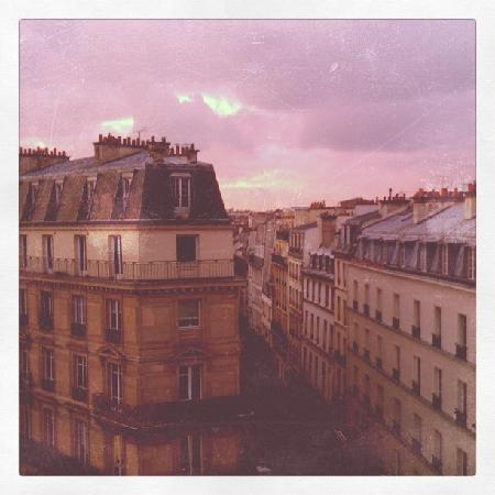 Paris France Hotel: Sunset over Rue Turbigo as seen from the open window