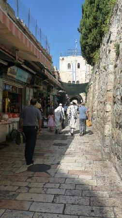 Austrian Hospice: The street directly at the entrance of the hospice. The hospice walls on the right, the Damascus