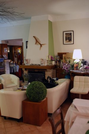 "Hotel Monterosso Alto: The ""front desk"" shares space with the dining area. A few comfy chairs are clustered next to the"