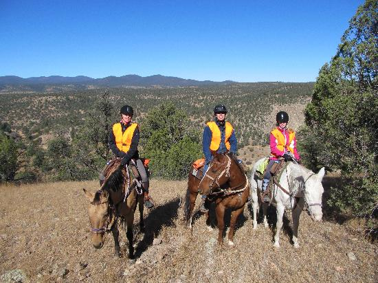 Geronimo Trail Guest Ranch: Family together. Bright vests because of deer hunt season. Never saw any hunters though.