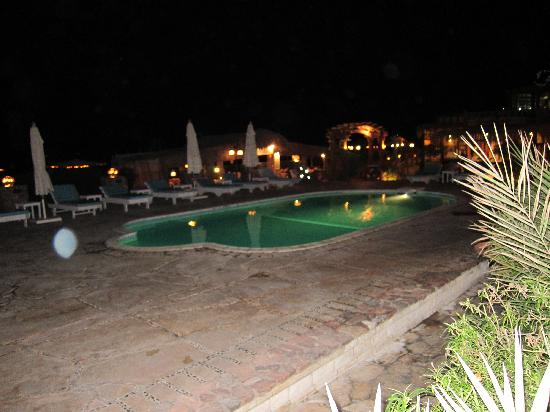 Coral Coast Hotel: view of the pool at night taken from our room
