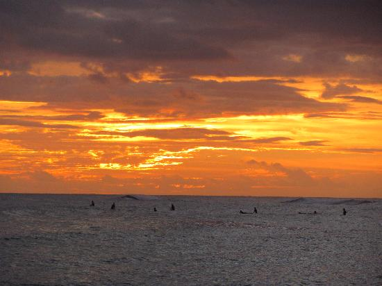 Poipu Beach Park: Surfers at sunset, Poipu Beach, Kauaii