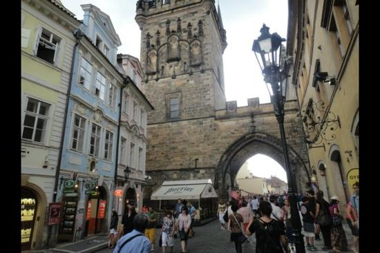 Charles Bridge Economic Hostel: blue building is the hostel, right next to Charles bridge - amazing location!!