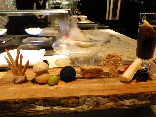 Tapas Molecular Bar: Appetizer with porcini, parma ham, potato, truffle and apple.