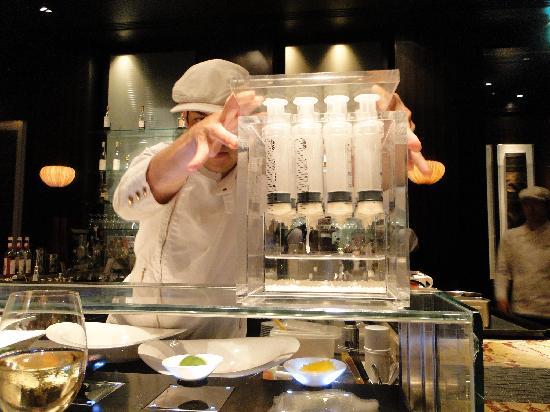 Tapas Molecular Bar: Chef Jeff Ramsey demonstrating the use of the 'caviar box' to make pearls.