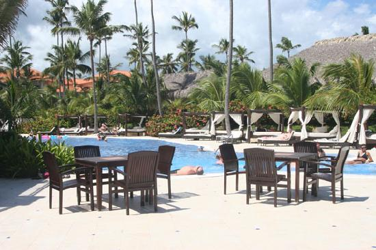 Majestic Elegance Punta Cana : tables around pool at club