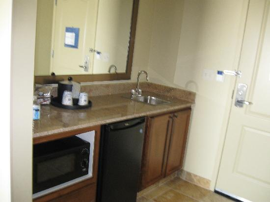 Hampton Inn & Suites Fargo: King Suite Balcony Room door and kitchenette area
