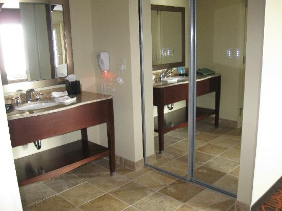 Hampton Inn & Suites Fargo: King Suite Balcony Room bath vanity and closet