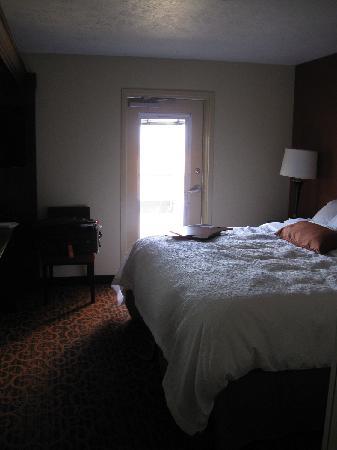 Hampton Inn & Suites Fargo: View of King Suite Balcony Room from the bathroom vanity