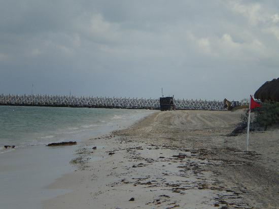 Excellence Playa Mujeres : Right side of beach has large cement structure sticking out into water