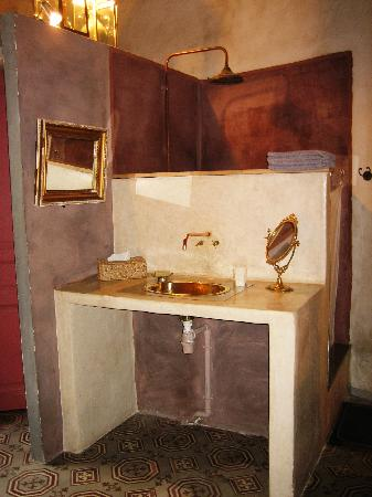 La Pousada: The copper sink in the room, with the shower behind it. Toilet is on the left hand side