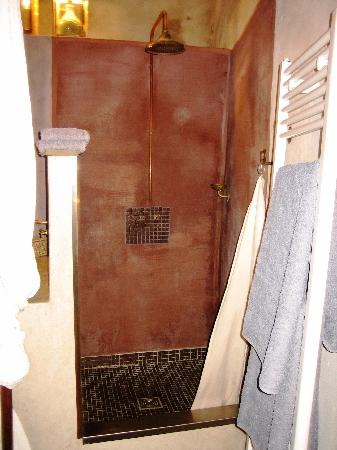 La Pousada: The old fashioned shower. The hanging white linen cloth with hooks on two side is the shower cur