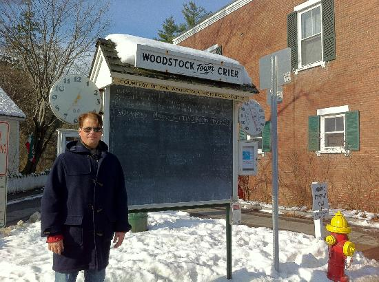Woodstock Town Crier: My husband Luke standing next to the Town Crier where the locals write in chalk what events are