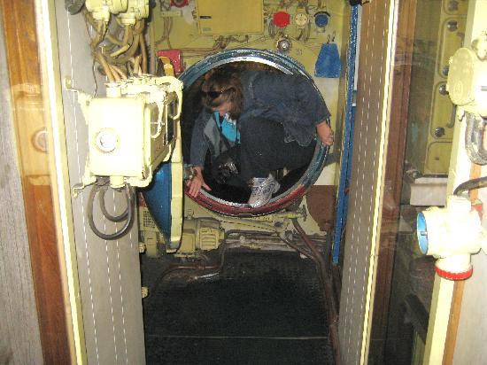 Scorpion Submarine: My mom, climbing through the sub.