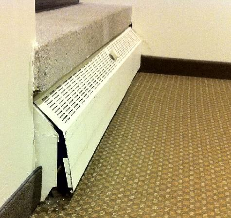 West Coast Suites at UBC: Broken heating panels in the corridor. One of many.