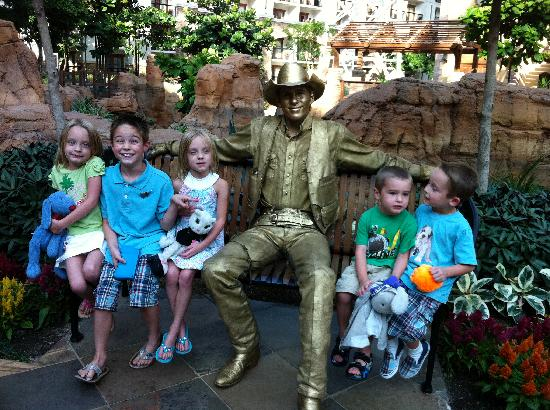 "Gaylord Texan Resort & Convention Center: ""grands"" sitting by a golden cowboy statue"