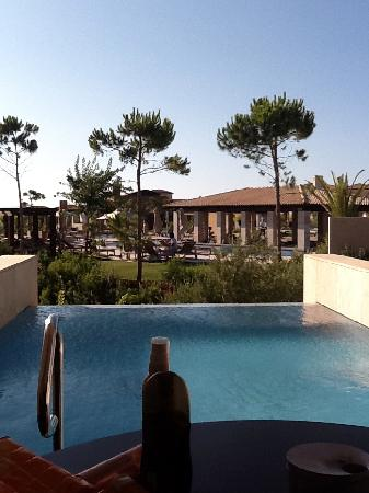 The Romanos Resort, Costa Navarino: Infinity pool and exterior view of the communal pool