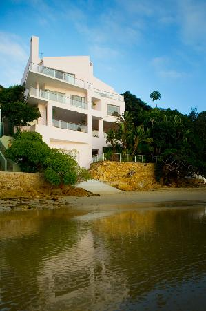 Milkwood Bay Guest House: Milkwood Bay Exterior - as seen from the lagoon, a small secluded private patch of beach under t
