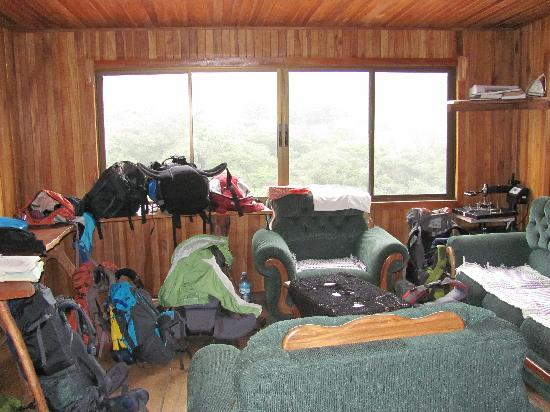 Sleepers Sleep Cheaper Hostel: Living area with all our backpacks