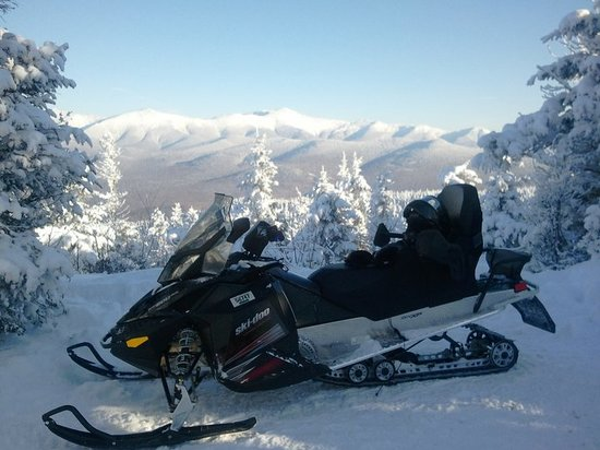 ‪SledVentures Snowmobile Rentals and Tours‬