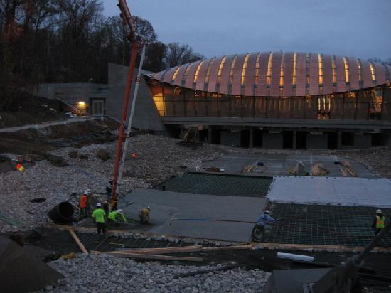 Bentonville, AR: Restaurant at night, construction of pond