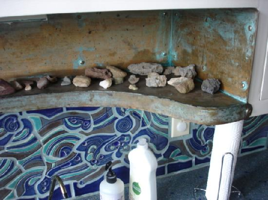 Earthship Biotecture: Love the custom tilework on the kitchen backsplash