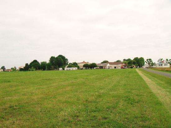 Camping Logis du Breuil : View from our Pich, over Play Field, towards Clubhouse,
