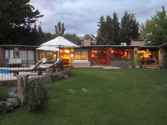 Lares de Chacras : grounds with pool and games room and bar with Asado in background