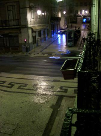 Lisbon Lounge Hostel: The view from the balcony of my room, this is the hostel's street on any night