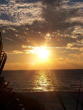 Tropical Beach Resorts: Amazing, Colorful Sunsets Illuminate the Siesta Sky