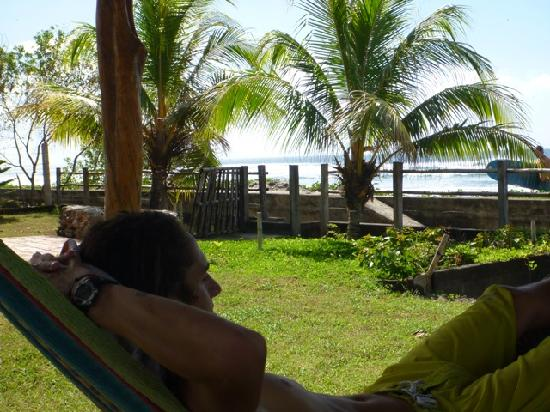 Popoyo Beach Lodge: Son Dominic lounging in lodge hammock with waves 20 yards away