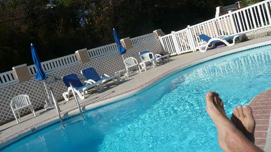 Clairfont Apartments: Feet up at the poolside. This is winter !!!!