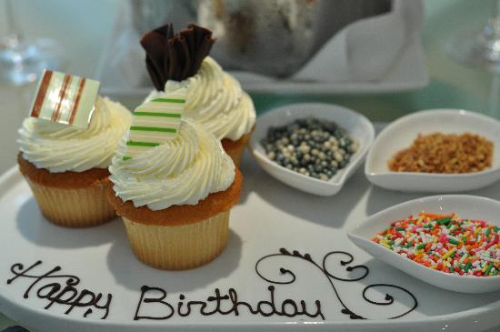 Happy birthday cupcakes with toppings Picture of Waldorf Astoria