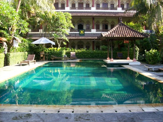 Bakung Sari Resort and Spa: pool area and superior room 218 where towel in hanging over balcony