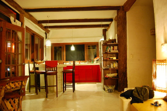 Mahayana Tulum Beach Homes: The living room and kitchen at night.