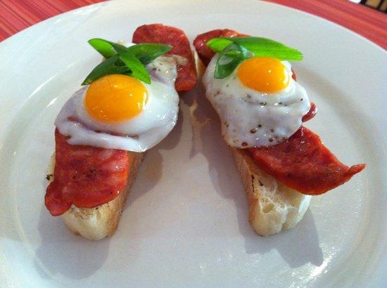 Alegria seafood bar: quail eggs & chorizo montaditto