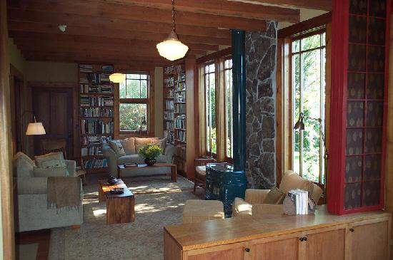 Point Reyes Schoolhouse Compound: The Living Room, Library and Woodstove with Views to the Garden